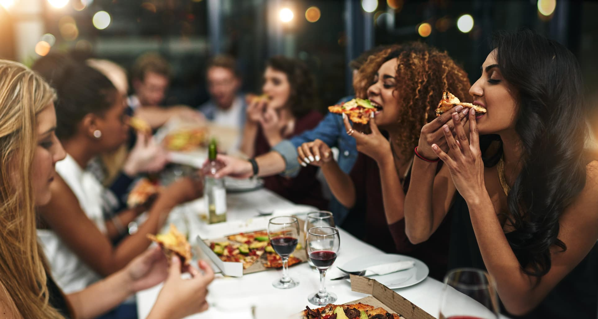 group-of-friends-eating-pizza-and-drinking-wine.jpg