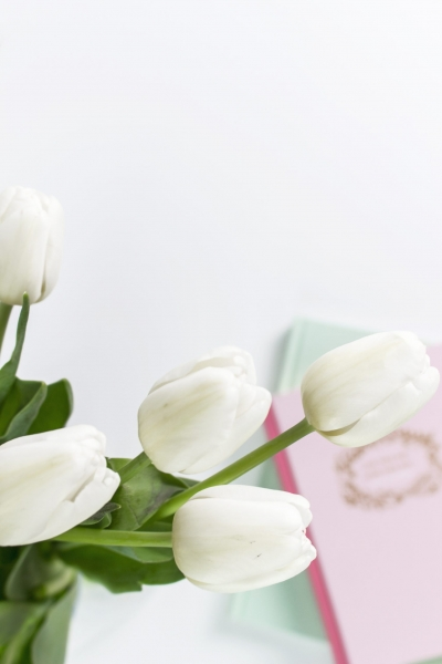 white flowers with journals in the background