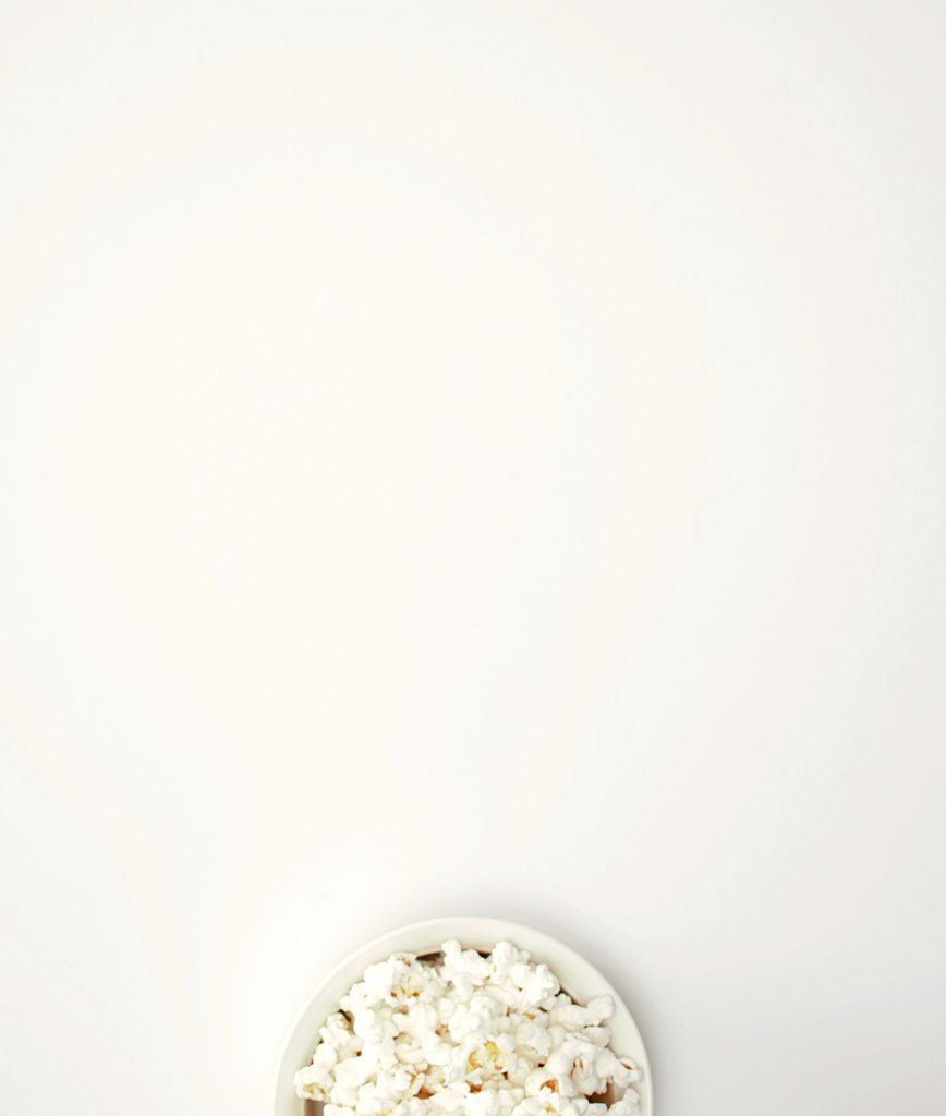a bowl of popcorn on top of a white background