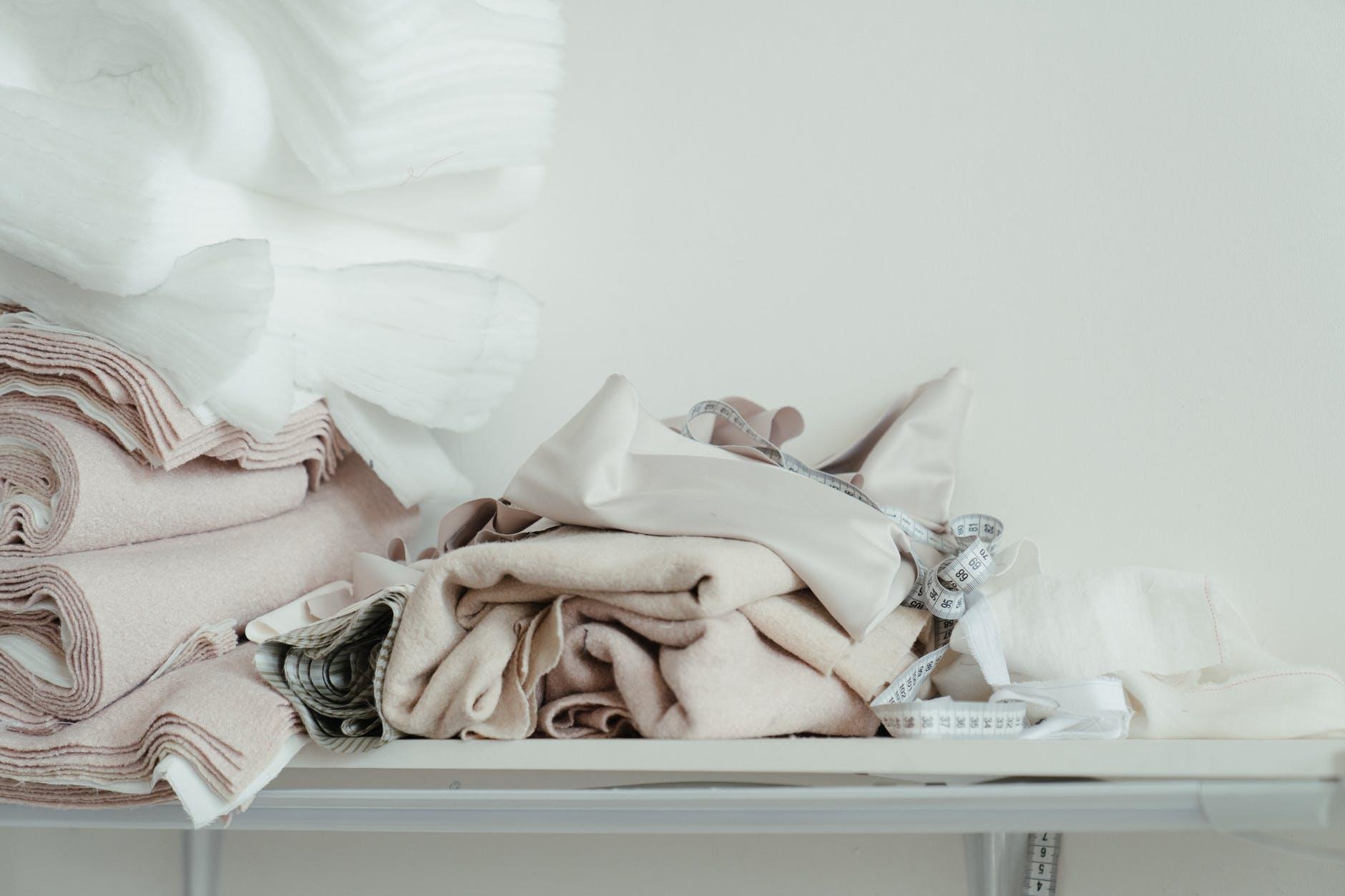 felt fabrics bundled on top of a table